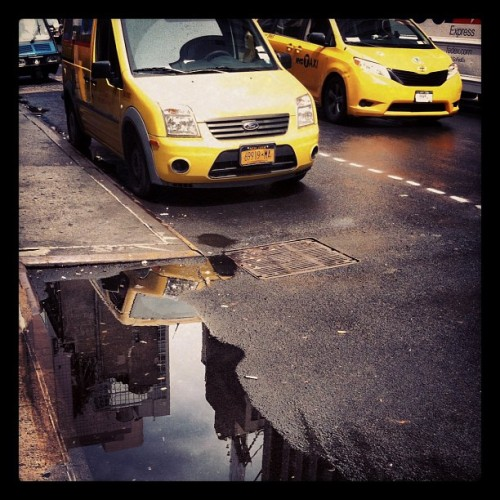 Remains of the rains. #taxi #shiftchange #midtown  (Taken with Instagram at Midtown)