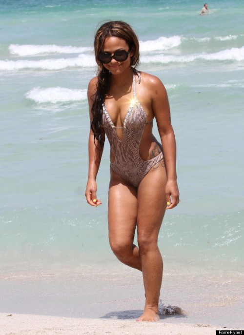 Christina Milian in a swimsuit from her line Havana Nights