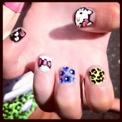 Hello kitty nails on 10-year-old Clara (Taken with Instagram)