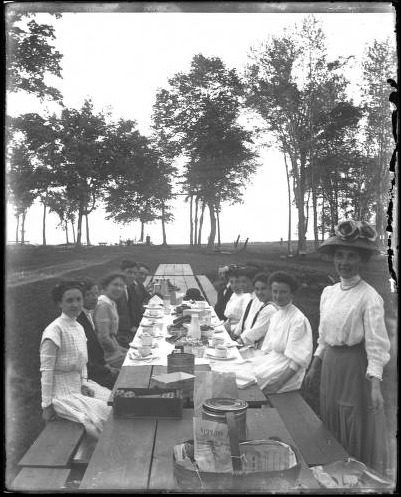 Men and women at a picnic table, Appleton, Wisconsin, ca. 1910. Glass negative by Chester Allen, an Appleton native and amateur photographer who graduated from Lawrence University in 1912. 89 of Allen's photographs are housed at the Lawrence University archives; 58 of those photos are available online. via: Lawrence University Archives
