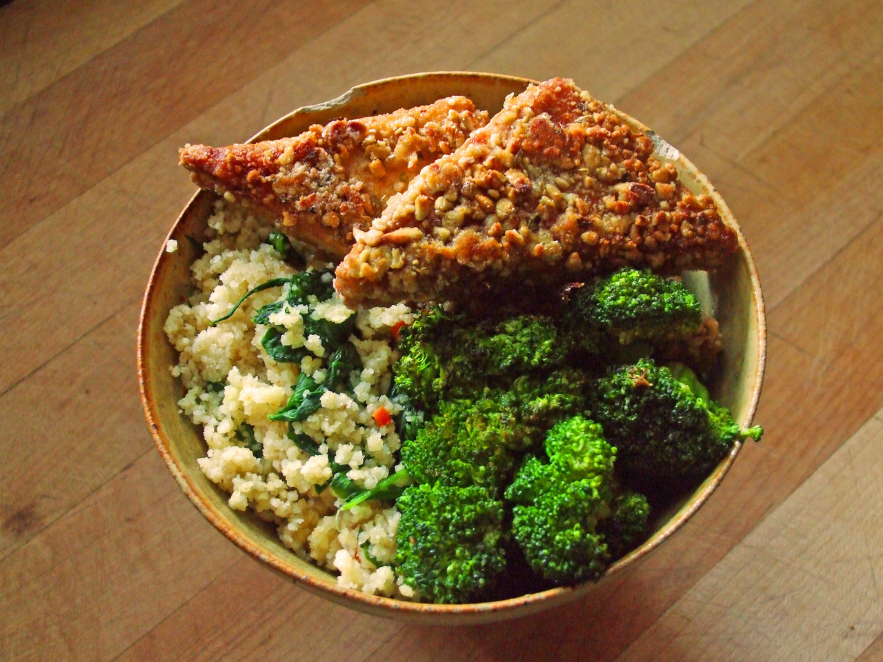 garden-of-vegan:  whole wheat couscous with garlic, onion, carrot, and spinach, sunflower seed crusted tofu, and sauteed broccoli