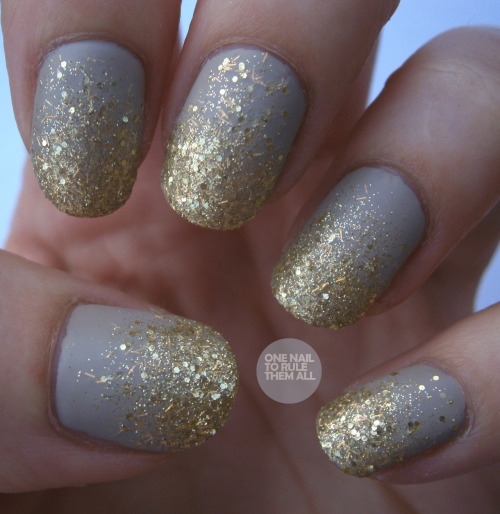 onenailtorulethemall:  Day 17: Glitter Nails. With a mattified gradient (shock horror).