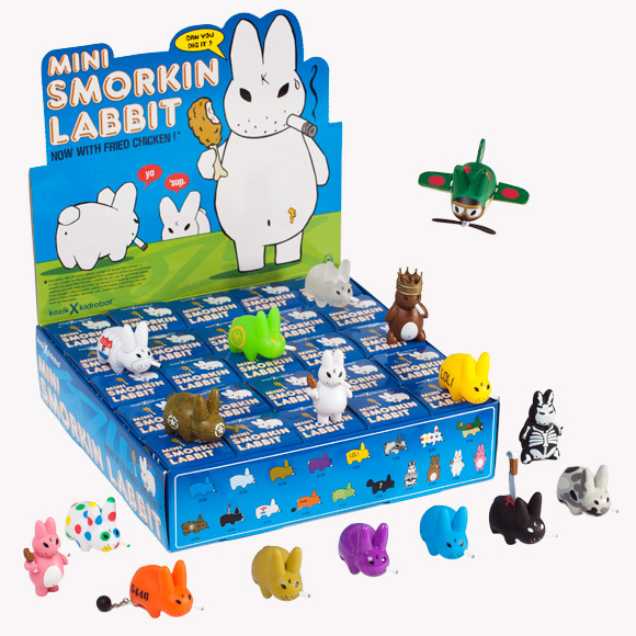 Smorkin' Labbit Mini Series Kozik and Kidrobot are at it again. On August 9, they'll release the Smorkin' Labbit Mini Series for $4.99 each. Some of the designs are really weird, especially the ones that are standing up, but there are some really cool figures in this series. The purple glossy Labbit and the inmate ones are class. Oh, and that airplane one is amazing.