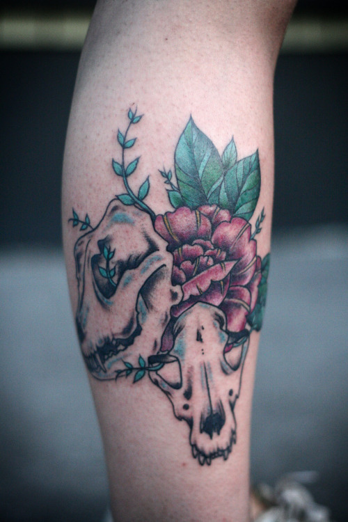dog skulls and flower on http://littleprints.tumblr.com!  tattoo by alice carrier at anatomy tattoo in portland, oregon.  http://alicecarrier.com