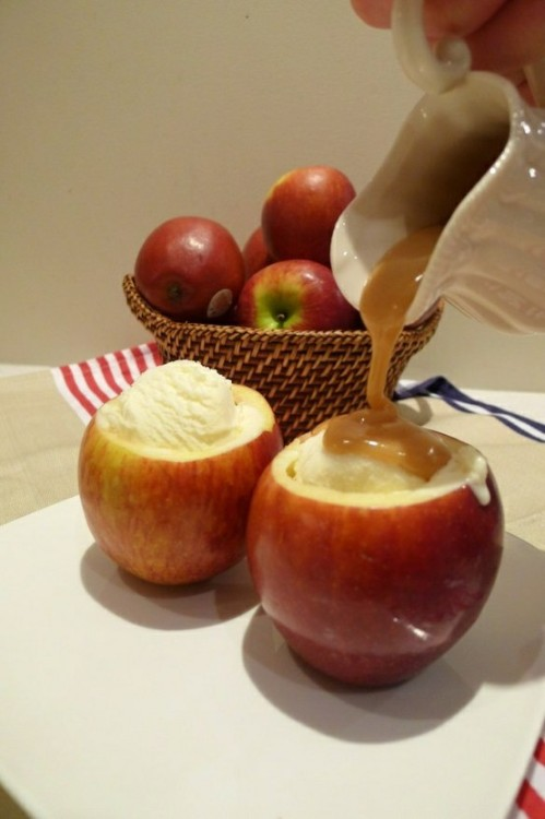 oooeygooeygoodness:  Baked Apple Ice Cream Bowls Ingredients:4 apples (hollowed out)1 tbsp sugar 1 tbsp cinnamonvanilla ice cream caramel topping Directions:Hollow out apples. Mix together sugar and cinnamon and add to inside of apples.  Bake at 350 degrees F for 20 minutes. When apples are baked, fill with vanilla ice cream and top with caramel.