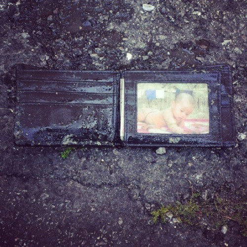 Hm so yeah @vmprmyth n I found this wallet in a DISGUSTING drain w a picture of a baby inside?? (Taken with Instagram)