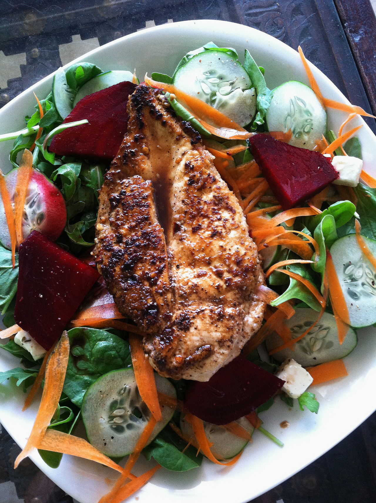 Homemade pan seared chicken with beet, feta, cucumber, carrot, arugula, and spinach salad.  -Braised Bombshell