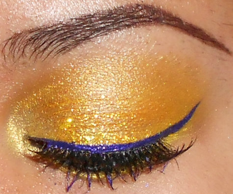 Yellow Eyeshadow with Glitter and Purple Eyeliner Tutorial http://youtu.be/bdBpkcFK3Oc http://www.youtube.com/user/makemeupbywhitney