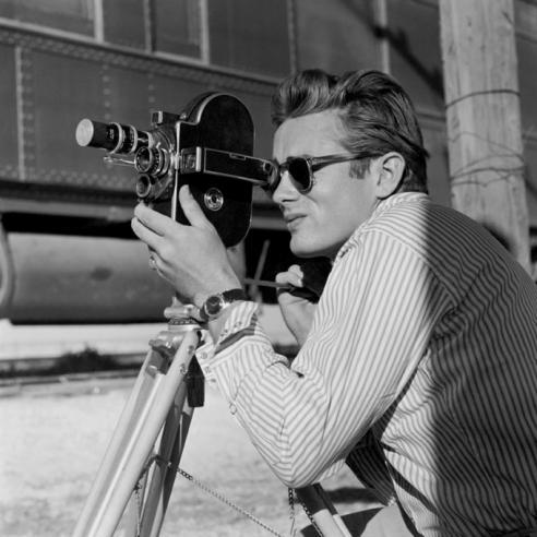 "phytos:  Sid Avery - James Dean close up with a Bolex camera on the set of ""Giant,"" 1955"