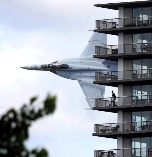 A Navy F/A-18F Super Hornet crew got permission for a low-level demonstration flight, as part of the opening ceremony for a speedboat race on the Detroit River