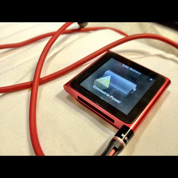 What happens #after a #long #flight and long #day - #red #ipod #charge #iphone #monster #beats #music #instagram  (Taken with Instagram)