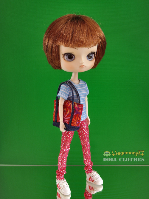 Dal doll in silver spotted pink pants and blue white striped T shirt with floral tote bag