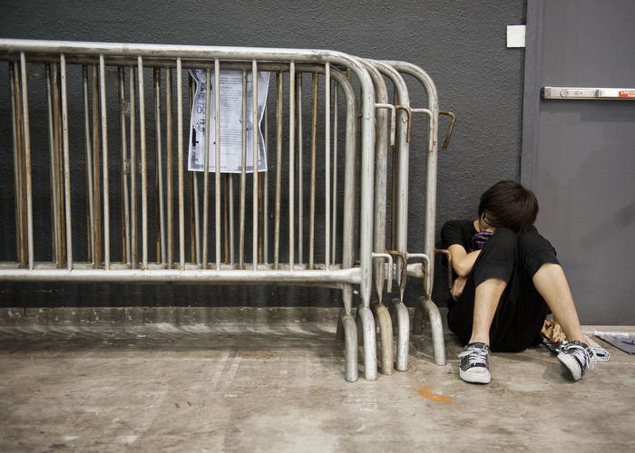 HONG KONG: July 31, 2012 — A man falls asleep during the 14th Ani-Com and Games exhibition in Hong Kong Tuesday, July 31, 2012. One of Asia's biggest animation and comic fairs opened on July 27 in Hong Kong, attracting thousands of fans and bringing some fun back into super heroes after the Batman movie shootings in Colorado. (Photo by JUSTIN CHIN)