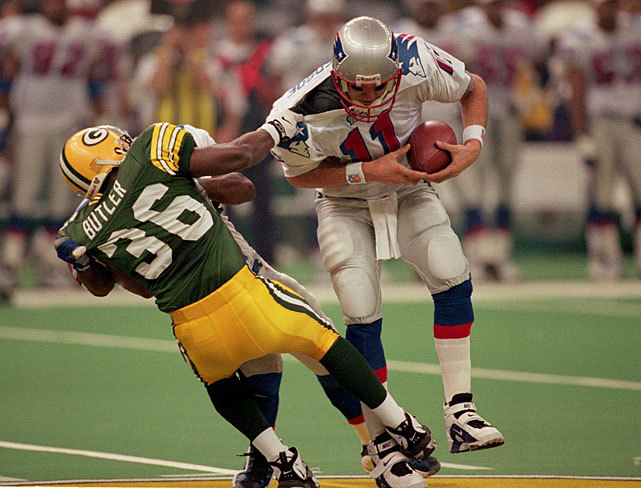 Patriots quarterback Drew Bledsoe is dragged down by Packers safety LeRoy Butler during the second quarter of Super Bowl XXXI. Green Bay would wind up victorious, defeating New England 35-21 in Bill Parcells' last game as Patriots coach. (John Iacono/SI) KING MMQB: Brees, Manning, Jones-Drew and other training camp thoughtsGALLERY: NFL Players Arrive at Training Camp | Training Camp: Historical Pics