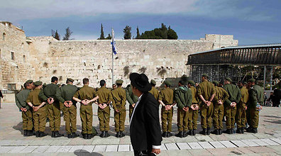 "IDF readies to enlist haredim Army prepares to recruit ultra-Orthodox soldiers after decades of granting sweeping exemptions; expiration of Tal Law could triple rate of haredi enlistment, officials say On the eve of the Tal Law's expiration, the IDF is preparing to sort potential haredi soldiers ahead of their enlistment, Ynet has learned. For decades, the IDF would send haredi youths preliminary draft summons before granting them exemptions under the Tal Law. With the legislation set to expire on Wednesday, the IDF is gearing towards enlisting the ultra-religious individuals, starting with an extensive sorting procedure that includes a variety of tests. Officials involved in the process postulate that the development will lead to the recruitment of 7,500 ultra-Orthodox soldiers each year, a number three times higher than the current rate. The expiration of the law, however, does not mean that the IDF will automatically stop exempting all haredim from service; changes to the current draft regulations are unlikely to go into effect before 2013.  A team consisting of Defense Ministry legalists and IDF human resources officials has recently drafted an interim directive meant to allow legislators extra time to come up with an alternative to the Tal Law, after attempts to draft such legislation in recent months failed. ""We are looking into the military's needs, and are discerning who is fit to be recruited while listening to the public's just demands for equality as well as the army and the haredim's demands,"" a senior member of the committee told Ynet.""(Defense Minister Ehud) Barak instructed the army to expand programs for ultra-Orthodox troops and to raise their salaries, which would replace the allowance that they currently get."" The political system appears to have given up on the issue, tossing the hot potato over to the defense establishment. The Knesset went into summer recess, and Minister Moshe Ya'alon, whom Prime Minister Benjamin Netanyahu put in charge of dealing with the draft legislation, has recommended the immediate establishment of new programs for the enlistment of haredim, instead of waiting for a new law. Protesters call for universal draft On Tuesday evening, activists belonging to the Suckers Camp, a movement demanding the enactment of a universal draft, intend to give out flowers on the streets of Bnei Brak, a predominantly religious central Israeli city.  The protesters also intend to distribute faux draft summons calling on potential ultra-religious soldiers to integrate within the army. ""The duty of service in the State of Israel applies to all of us… This is a mighty opportunity for all of us to create one society, under on law, where everyone serves the state,"" the leaflets read. ""No one wants to enlist you forcefully; no one wants to alter your way of life. We are brothers; we always have been and always will be."" The National Student and Youth Council has also joined the battle, sending Netanyahu a strongly-worded letter urging him to enact universal army service. ""Don't let Zionism turn into cynicism,"" wrote Yuval Kahlon, the chairman of the council. ""We don't care about politics, we only care about how our lives will look like in a future State of Israel. How do you expect us to proudly fulfill our duty with this blatant discrimination tearing at our immense motivation?"" Various protest movements are expected to join forces on the weekend to call for the equal sharing of the service burden and to express objection to the recent tax hikes. ""The decision to favor the ultra-Orthodox interest over the general public's interest when it comes to the draft question, the failing attempts to dissolve Kadima and the outrageous financial edicts are like spitting in the public's face,"" said Idan Miller, who heads the unified protester camp."