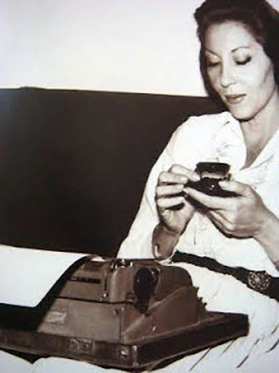 Clarice Lispector reads, writes, sips tea.