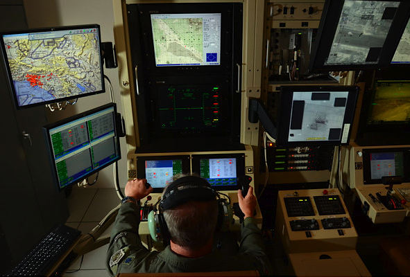 "Drone Pilots, Waiting for a Kill Shot 7,000 Miles Away | NYT  From his computer console here in the Syracuse suburbs, Col. D. Scott Brenton remotely flies a Reaper drone that beams back hundreds of hours of live video of insurgents, his intended targets, going about their daily lives 7,000 miles away in Afghanistan.  Sometimes he and his team watch the same family compound for weeks. ""I see mothers with children, I see fathers with children, I see fathers with mothers, I see kids playing soccer,"" Colonel Brenton said. When the call comes for him to fire a missile and kill a militant — and only, Colonel Brenton said, when the women and children are not around — the hair on the back of his neck stands up, just as it did when he used to line up targets in his F-16 fighter jet. Afterward, just like the old days, he compartmentalizes. ""I feel no emotional attachment to the enemy,"" he said. ""I have a duty, and I execute the duty.""  Read on."