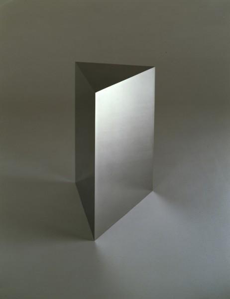 Alpha-1 (1988) Stainless steel 15 1/8 x 9 7/8 x 9 3/8 inches (38.4 x 25 x 23.8 cm) by John McCracken