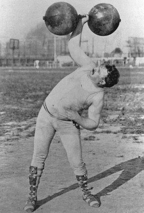 "cabbagingcove:  Frederick Winters at the 1904 Summer Olympics in St. Louis From the little I can gather, Frederick Winters was a ""strongman"" in a carnival for some time, and claimed a silver medal at the 1904 Olympics for ""Men's All-Around Dumbell"" - an event intended to determine the overall weightlifting champion, and held over the course of two long days. Of course, given that there were only three competitors, it wasn't much of an ""All-Around"" anything, much less championship, but Winters performed admirably nonetheless. His top lift was 45 kg. Olympic Multimedia Foundation, 1904; Public Domain"