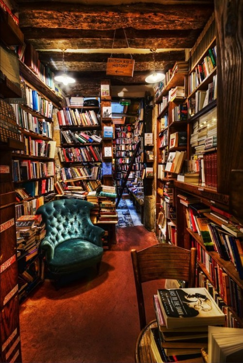 "fool-ofatook:  Oh my goodness! I went to this bookstore in Paris today. It's called ""Shakespeare and Company"" and it's beautiful. It's cramped and feels homey and books are literally overflowing from the shelves and stacked on teetering piles. You can find books on absolutely everything… and most of it is in English as well. Simply trying to find a book is an adventure in itself and even though it seems disorganized because of the haphazard placement of the books and shelves, it's actually really intricate in that everything has its place. They even have a beautiful poetry section in this little niche off to the side. And quotes by famous authors are painted on the walls and on chalk boards. At the very top they have a piano (I'm not sure if you're free to play it, or not) and this nook where they have old, leather-bound books, which you're only allowed to read there — but not buy. And people stuck messages on post-its and wrote little letters and these messages cover the walls that aren't already covered by bookshelves. And there are chess boards and children sit with their grandfathers and play a game of chess while the sun outside is burning into the concrete and for just a moment things seem so very peaceful. Best best best day in Paris."