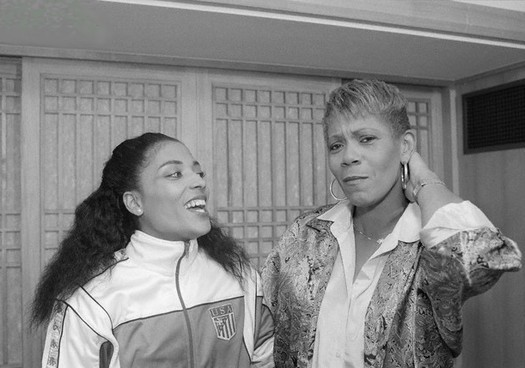 Florence Griffith-Joyner posing next to the legendary sprinter Wilma Rudolph during the celebration of the Olympic Games in Seoul 1988.