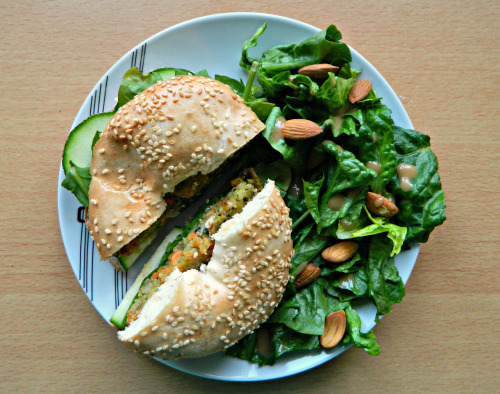 seedsnsmiles:  -Toasted sesame seed bagel with hummus, courgette, spinach, nut cutlet and sweet chill sauce and a romaine & almond salad with a ginger/sesame dressing.