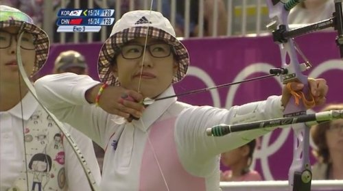 douglaswolk:  South Korea's women's archery team won its seventh straight Olympic title on Sunday, scoring a nine on the final arrow to defeat China in the gold-medal match. That the archers did it while dressed like they were on their way to the Best Coast show in Williamsburg was an even greater achievement. The three women on Korea's dominant team won gold wearing plaid bucket hats, pink and white buttoned-up shirts, beaded bracelets and black-rimmed glasses. One even had a vest that depicted small Korean girls shooting arrows, the ultimate in self-referential hipstertude. (via South Korea's hipster archers unironically win gold | Fourth-Place Medal - Yahoo! Sports)