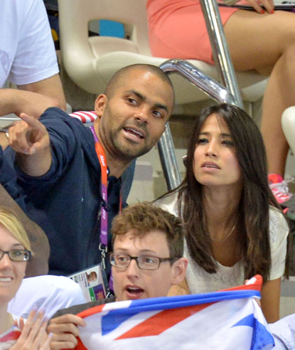 NBA star Tony Parker attends the swimming competition with his girlfriend Axelle held at the Aquatics Center during the 2012 Olympic Games on July 31.