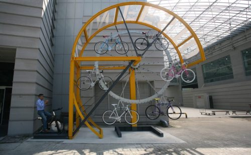 The Bike Hanger from Manifesto. via timbuk2. it's like a bike ferris wheel! would be awesomer if it was larger and lit-up, and you could still sit on your bike