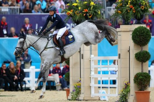 olympics:  Sara Algotsson Ostholt of SWE riding Wega negotiates a jump Individual #Equestrian Final on #day4 of the #olympics