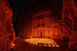 "owlghosts:  Petra - an ancient capital of the Nabatean Kingdom - is a city famous for its rock-cut architecture which was lost for centuries in sands and mountains. For many years Petra had been neglected and devastated before, in the 18-th century, it was reestablished for the mankind. Since that time there are a lot of tourists in Petra and it has been recognized as one of wonders of the World. Sometimes during performances with candles you can imagine the way Petra looked two thousand years ago in the time of its prime. (""2000 years ago. Petra, Jordan "" by Sergey Ershov)"