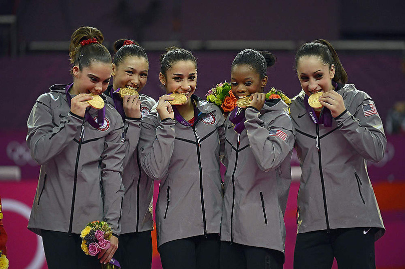 FAB 5 // McKayla Maroney, Kyla Ross, Alexandra Raisman, Gabrielle Douglas and Jordyn Wieber bite on their Gold Medals after winning 2012 London Games Gymnastics