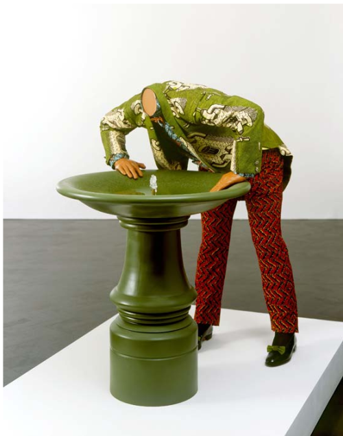 "cavetocanvas:  Yinka Shonibare, Headless Man Trying To Drink, 2005 From the National Museum of African Art:  This sculpture presents an incongruous situation—a man who is headless trying to drink from a water fountain. The absurdity of this scenario is reinforced by the patterning of the man's costume, which features the doubled motif of an abundantly flowing tap and water glass. His elegantly tailored late Victorian costume suggests he is someone of note—a well-to-do gentleman of colorful taste. Jaunty red trousers and green bows on his patent leather shoes lend a foppish note to the figure and extend Shonibare's longstanding interest in the notion of the ""dandy."" Shonibare typically presents his sculptural figures minus their heads. In doing so, he makes playful reference to the French Revolution and the beheading of members of the ruling elite. The absence of heads also removes references to individual or racial identity in his figures.The man's inability to drink from the tap is particularly ironic in the present era. Water shortages, drought and climatic shifts have affected various parts of the world; and leading environmentalist David Suzuki, for one, proposes that the world's future wars will be fought over water, not land. This work is Shonibare's only ""animated"" sculpture to date, featuring a water pump and running water."