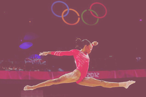 Gabby Douglas performing her balance beam routine as she helps lead the USA Women's Gymnastics team to gold.