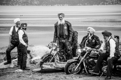 Sikh motorcycle club candid from Vancouver, BC. A Sikh Motorcycle club was doing a photoshoot on the beach and I was able to grab a few candids between their shots. (Brian Kushniruk)