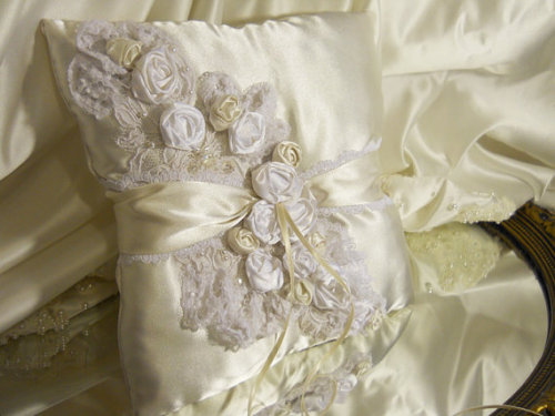 Wedding Lace Ring Bearer Pillow, handmade of ivory satin and off white wedding lace with satin handmade rosettes.
