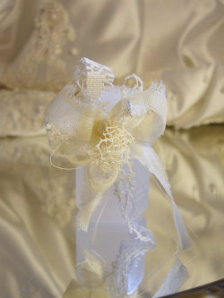 Set of 12 Wedding Bubbles with small ivory lace bow ties. Matches the larger burlap bow ties for champagne glasses.