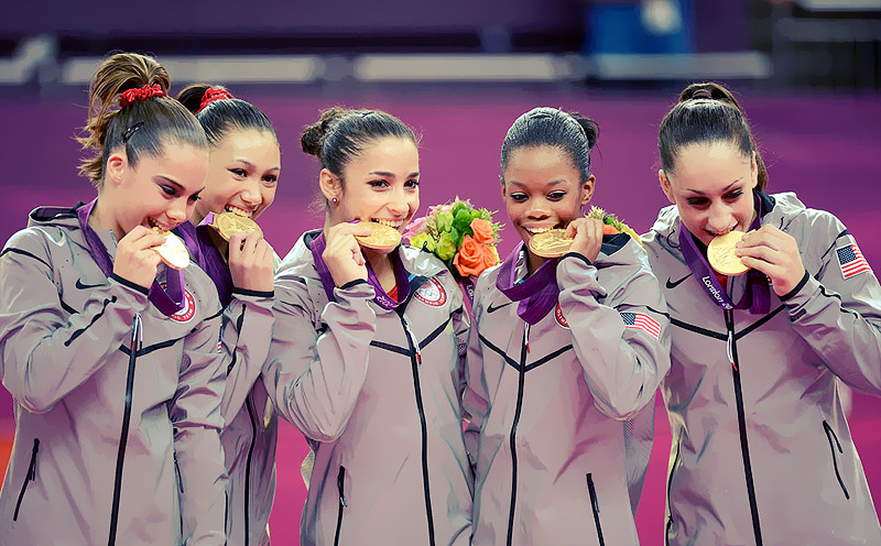 OLYMPICS DAY 4 USA Gymnasts McKayla Maroney, Kayla Ross, Aly Raisman, Gabby Douglas and Jordyn Wieber pose with their Olympic Gold medals.