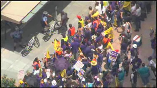 "Protesters arrested in ongoing strike over janitors' wages in HoustonAugust 1, 2012 Protestors were arrested Tuesday during a march in the name of Houston janitors. It's the latest in an ongoing strike for higher wages. The janitors promised civil disobedience and that's exactly what happened. Several people were arrested, but their message is slowly getting through. They marched, chanted and were determined to make a point. Striking Houston janitors and their supporters walked through parts of downtown Houston before making their way inside One Allen Center. Once in, the janitors threw flyers through the lobby before several sat down in an act of civil disobedience, refusing to leave until they were arrested. ""The Houston janitors are making about $9,000 a year, not enough survive in Houston or anywhere as a matter of fact,"" Janitors Organizer Elsa Caballero said. Also made their voices heard at city hall, where retired Archbishop Joseph Fiorenza spoke on their behalf. ""They are giving four five hours at nighttime, and it's hard work, and they're not paid very much,"" Fiorenza said. The janitors want their pay raised up to $10 an hour at the end of a multi-year contract. For now, contracting companies have been unwilling to budge, even though many of Houston's elected leaders have voiced their support. ""I stand in support with them in their efforts,"" Councilman Ed Gonzlez said. Source Houston area followers: Attend the rally to support these striking janitors who are fighting for a living wage! Today at 6 p.m.! At the Williams Tower! Facebook event here."