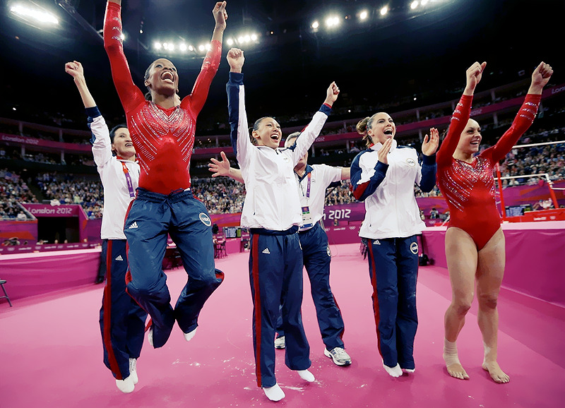 OLYMPICS DAY 4 US Gymnast Gabby Douglas, Kayla Ross, McKayla Maroney and Jordyln Wieber jump with joy as teammate Aly Raisman finishes her floor exercise.