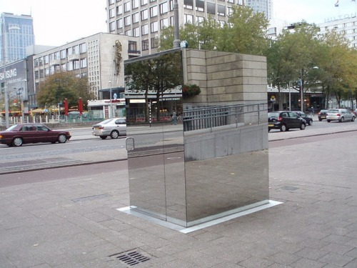 quitechanel:  This is a bathroom where people can't see you but you can see them so if they were to look in the mirror it would seem as if they were looking right at you but they really can't see a thing. You would feel completely exposed to the neighborhood as if you were in a box of clear glass.