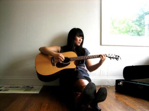 Singer/songwriter Jane Lee is one of our August 2nd WOMYN SHOW features. How does art empower her as a womyn?  ever since i was a little girl, singing was an emotional and spiritual outlet for me. no matter how beat down i was, when i was singing i felt free. as a child, when i was upset or frustrated, i remember going to my room, slamming my door shut, picking up my walkman, blasting wilson phillips and singing at the top of my lungs. over the years, i've come to recognize what a special gift music has been in my life. to this day, when i'm feeling stressed, overwhelmed, or burdened, i find somewhere i can be alone, pick up my guitar, strum a simple melody over and over again and just sing whatever is on my heart, no matter how incoherent or nonsensical it may sound. it's one of the few spaces that i can feel completely unconstrained from the limitations and pressures society imposes on me as a womyn, as asian american, as a young person… songwriting provides a venue for me to vent, reflect, dream, process my thoughts and feelings, and just sing it out and release it. it's been a huge part of my healing and growth process, and i hope to continue to grow as an artist who writes honest music that not only empowers myself, but inspires and empowers others.  The show is tomorrow. Come see Jane Lee and other amazing womyn share their art live on stage!