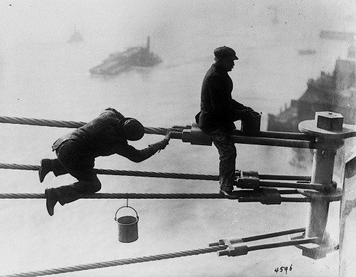 Brooklyn Bridge painters at work high above the city, on December 3, 1915.  From NYC Municipal Archives