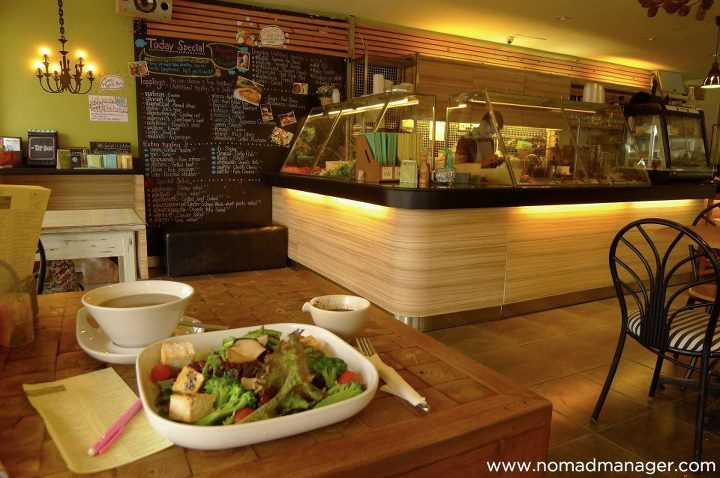 Cheap Vegetarian Eats in Chiang Mai, Thailand A pleasant surprise I've come to realize on this trip is that it really isn't that hard to maintain a vegetarian diet while traveling. You can always find yummy vegetable dishes or salads, and you can always ask people to omit the meat in your Phad Thai or replace it with veg-friendly tofu. I've also found that vegetarian dining can be the easiest to your pocket, and that was especially true for me in Chiang Mai. [[MORE]] Clean food, dirt cheap As mentioned in my post about my guesthouse in Chiang Mai, there was a ridiculously cheap Chinese vegetarian resto located literally a minute away (along Prapokklao Rd.), selling real cheap food.  How cheap?20THB - 1 viand + 1 rice ~ yep, that's $0.66 or 26PHP25THB - 2 viands + 1 rice ~ WTF   But even before I found that, I actually accidentally discovered this other Chinese vegetarian resto (located along Rachadamnoen Rd.) right before meditation with Tiko at Wat Sri Gerd.   And yup, they sell their food at the same price as Tein Seng (resto in 1st photo). And both establishments provide free water to diners. Honestly, I don't know how they still make money. Clever take on salad When you're feeling a little fancy, you can also shuffle on down to Nimmanhaemin Rd. on the west side of Chiang Mai and pay a visit to Salad Concept. For only 50THB - 65PHP or $1.66 (and this is also relatively cheap in Thai standards considering the ambiance of the place), you get a base of greens along with 5 free toppings and your choice of salad dressing. They also have more premium toppings that you have to pay a little extra for, but still.  It was hard to decide but I wound up getting a salad of 1) tomato, 2) broccoli, 3) asparagus, 4) grilled mushroom (yum!), 5) red bean (for protein), and got and add-on of tofu (20THB ~ 26PHP or $0.66), all to be enjoyed with my delicious tamarind sesame dressing (though I would have loved to try the passion fruit dressing too!). I also decided to go all out and order a shiitake mushroom soup (69THB ~ 91PHP or $2.33 - ironically more expensive than the salad), which I thoroughly enjoyed.  Stevie approved of my order too. It really wasn't one of those tiny, tiny salads you might get in the Philippines for the same price.  I loved the restaurant design as well, both indoors…  …and outdoors.  It always adds extra pogi points when a business cares about the earth, and uses funky wall decals too.  I was later joined by Ro, the Thai guy I met on the train from Bangkok to Chiang Mai, and his friend Jane, who would both unexpectedly take me to one of the prettiest places near Chiang Mai. But more on that in a succeeding post. But yeah, bottom line, traveling as a vegetarian is fun! :) Leafy greens,Jen Follow my tweets • Find me on Facebook • Sign up for my newsletter • E-mail me