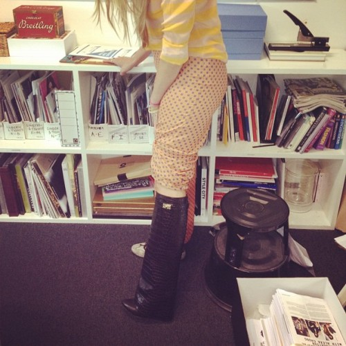 Our shopping editor @lilyrusso trying on the Givenchy wedge boots in the office (Taken with Instagram)