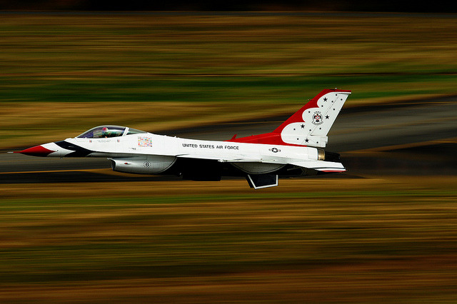 Thunder streak. youlikeairplanestoo:  Capt. Blaine Jones, Thunderbird 6 Opposing Solo pilot, takes off during the Joint Base Lewis-McChord Air Expo, July 22, 2012. (U.S. Air Force photo by Staff Sgt. Larry E. Reid Jr.)