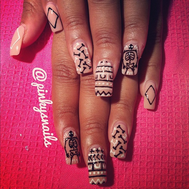 An intricate nude mani by Esther with skeletons ! (Taken with Instagram)