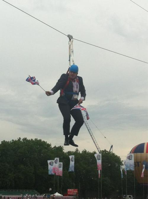 Boris Johnson, Mayor of London, stuck on a zip wire in Victoria Park, London.Gawd bless you BoJo!  Image: BT London Live