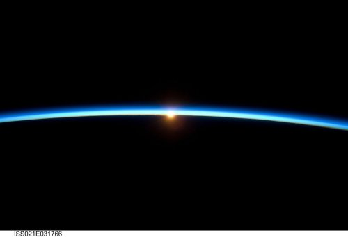 The thin line of Earth's atmosphere and the setting sun are featured in this image photographed by the crew of the International Space Station while space shuttle Atlantis on the STS-129 mission was docked with the station. [Another one of the amazing images that NASA has produced over the years - ed]