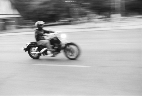 Motorcycle rider on Milwaukee Avenue at Logan Square.
